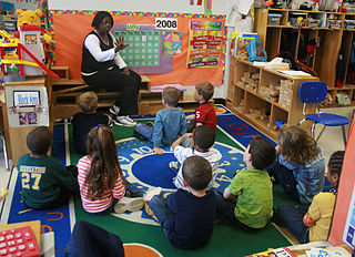A teacher and her students in an elementary school classroom
